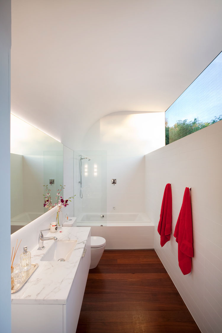 In the bathroom a curved ceiling scoops in the light without compromising privacy at Westbury Crescent Residence