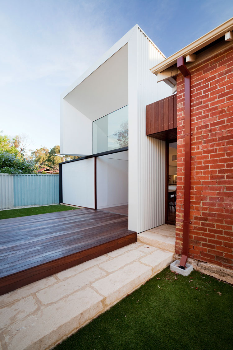 Sandstone steps and a timber deck define the connection between indoors and outdoors at Westbury Crescent Residence
