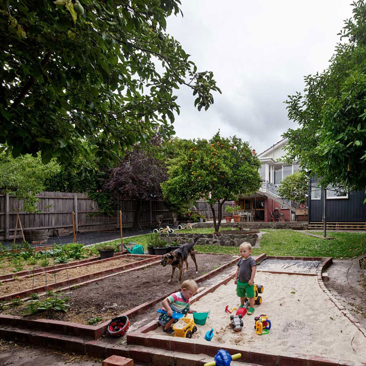 Amy's House garden beds are raised using recycled bricks to create vegetable gardens and a sandpit