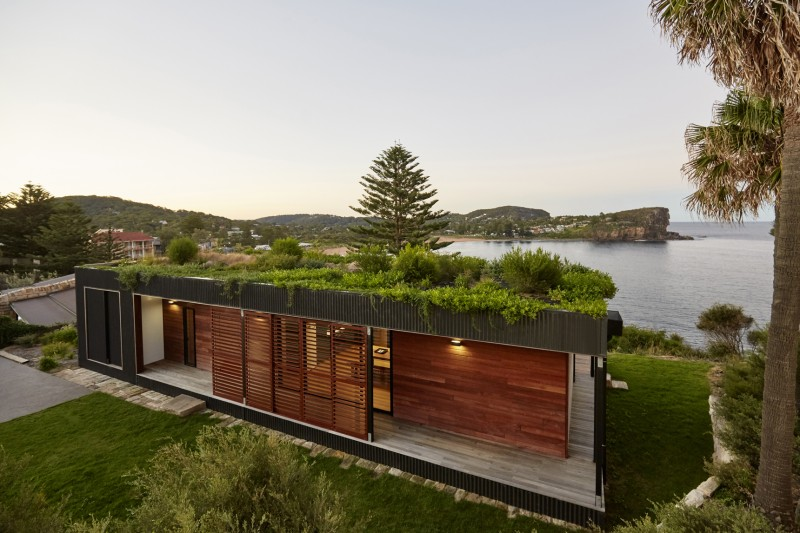 This Green Roofed Beach House Arrived on the Back of a Truck