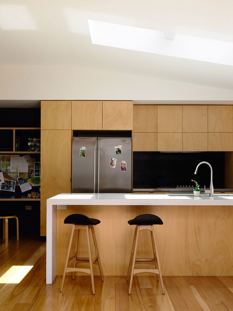 Batten and Board House Kitchen is lit by a North-facing skylight