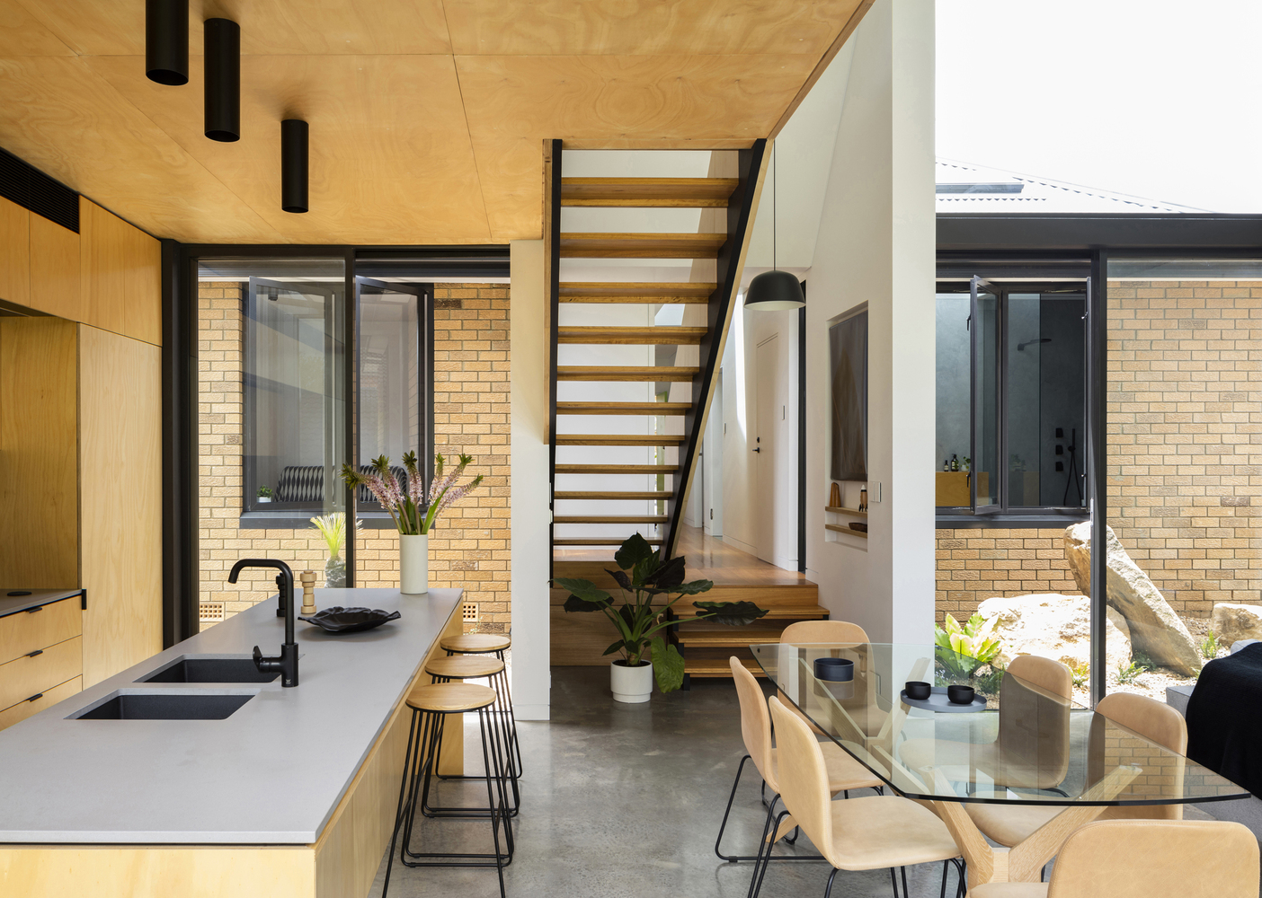 Contrasting Addition Complements a Sixties Yellow Brick Home