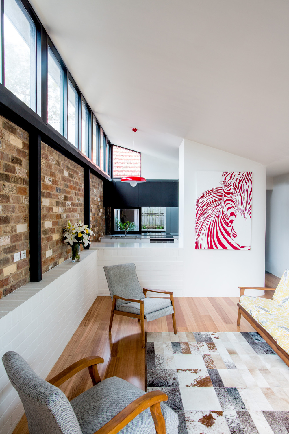 Reclaimed Bricks Provide Warmth and Solidity to Otherwise Light Home