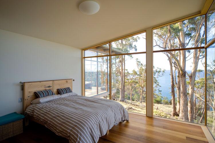 Bruny Shore House bedroom has a large window overlooking the ocean