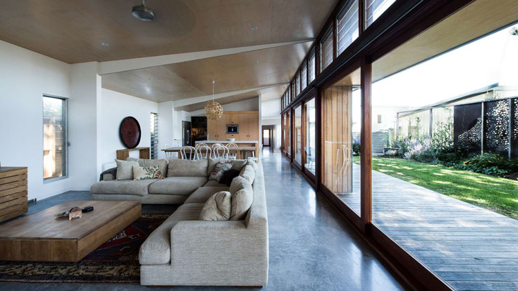 Redhead Alterations open plan living area sits on a concrete slab for passive solar heating/cooling
