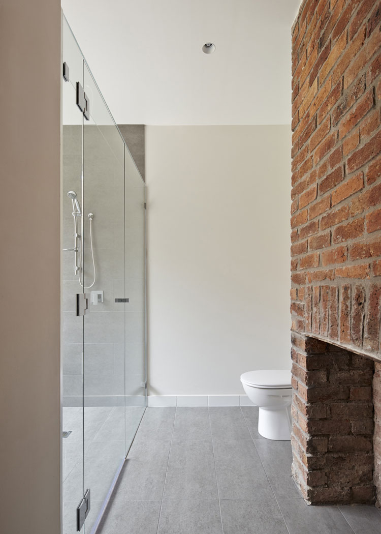 Engawa House bathroom with original brick fireplace