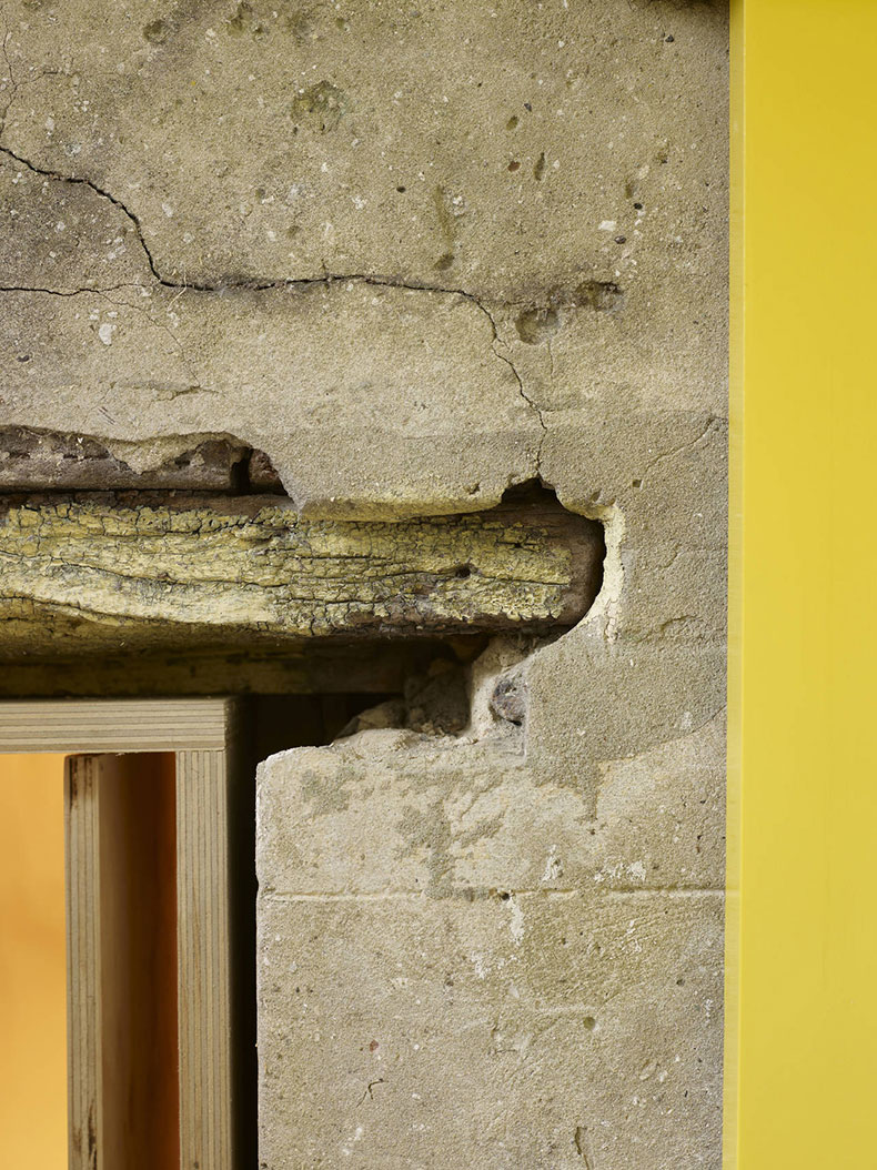 An old timber lintel against original render is left intact and the existing open is lined with a new plywood dressing at Fitzroy Terrace in Sydney