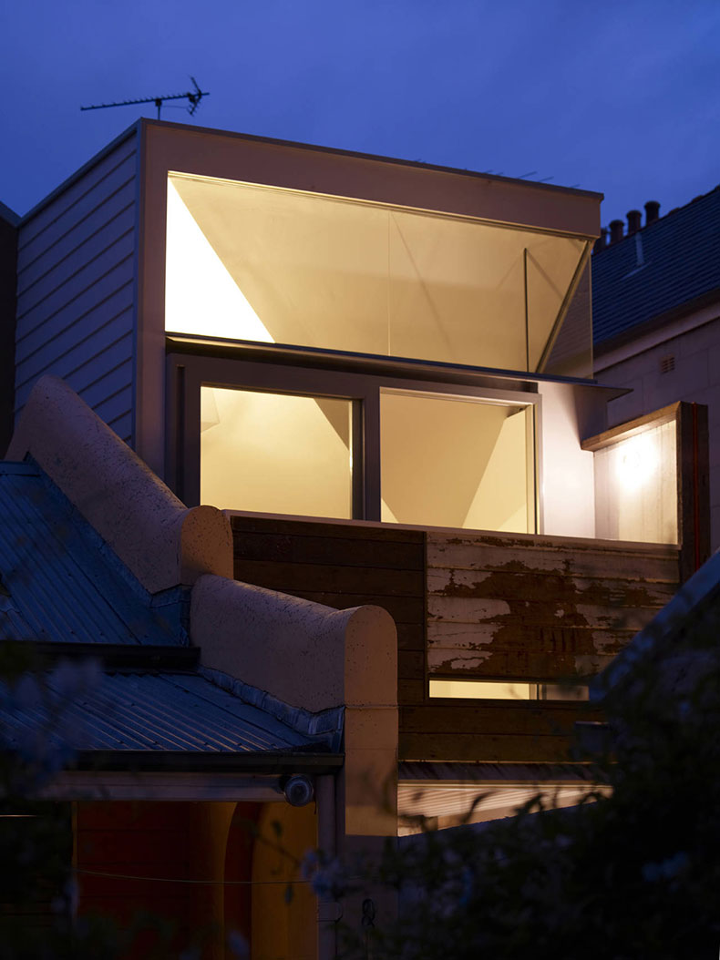 At night Fitzroy Terrace in Sydney's new rear extension glows against a patina of finishes