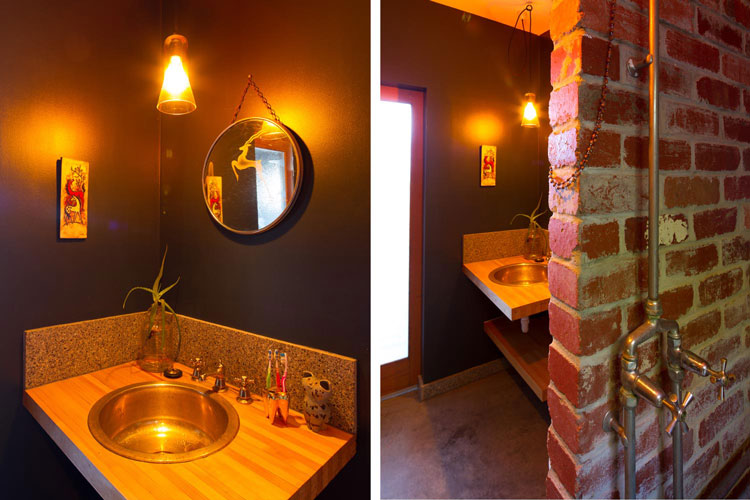 In the bathroom of Florence Street House, an old bowling alley is used at the bathroom cabinet