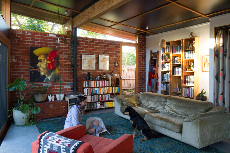 In the living area of Florence Street House you can see the exposed brick walls, exposed rafters and exposed concrete floor