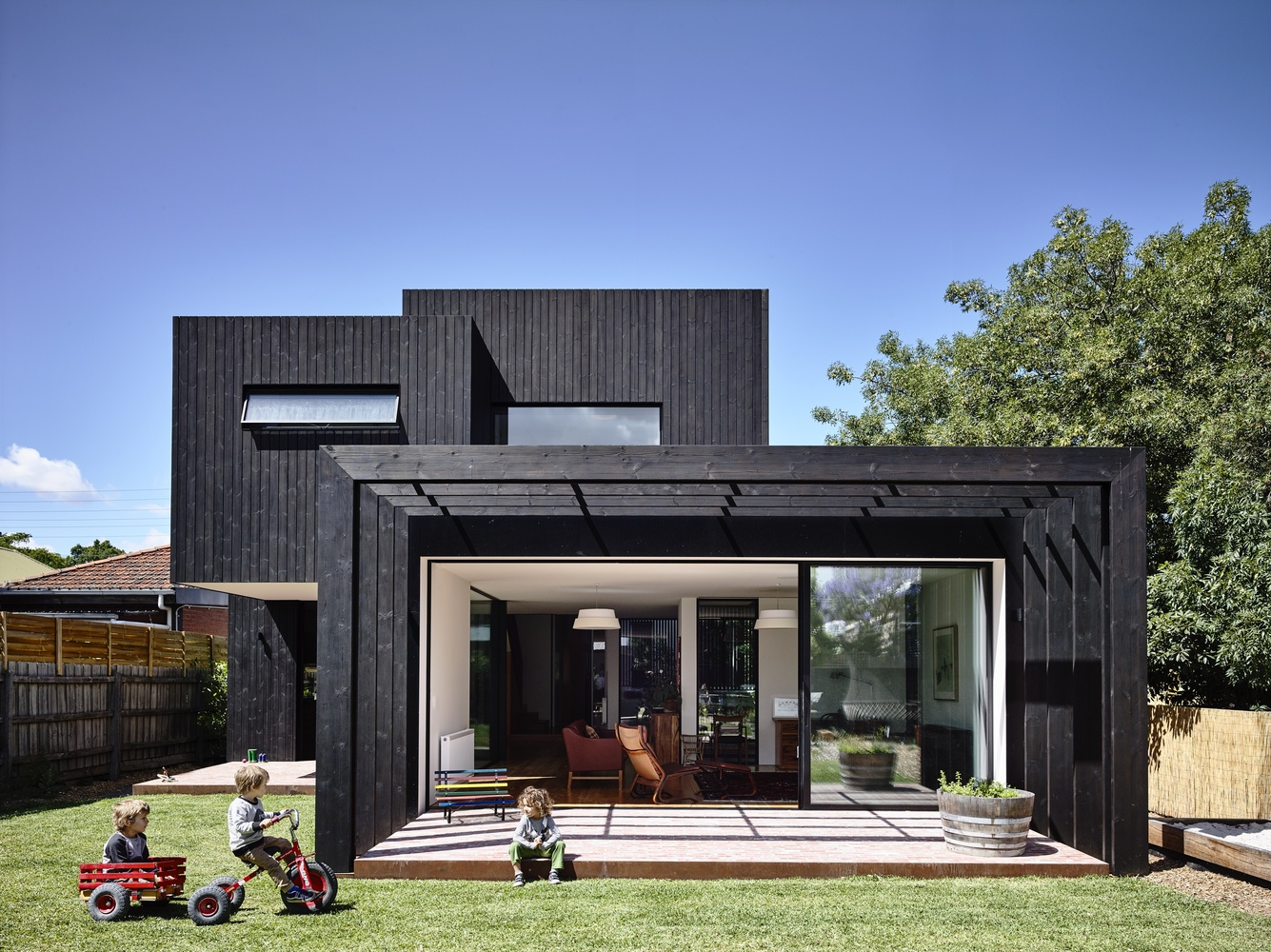 An Elegant Black Timber Extension Compliments a 19th Century Home