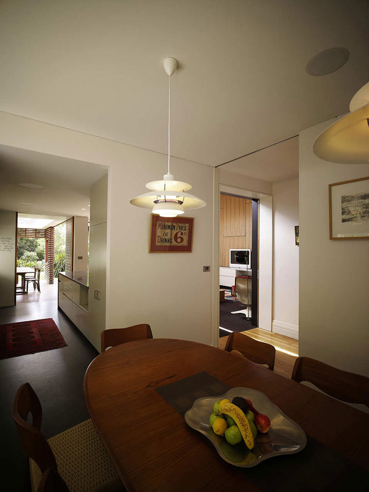 Haberfield House dining room opens into the kitchen and living area