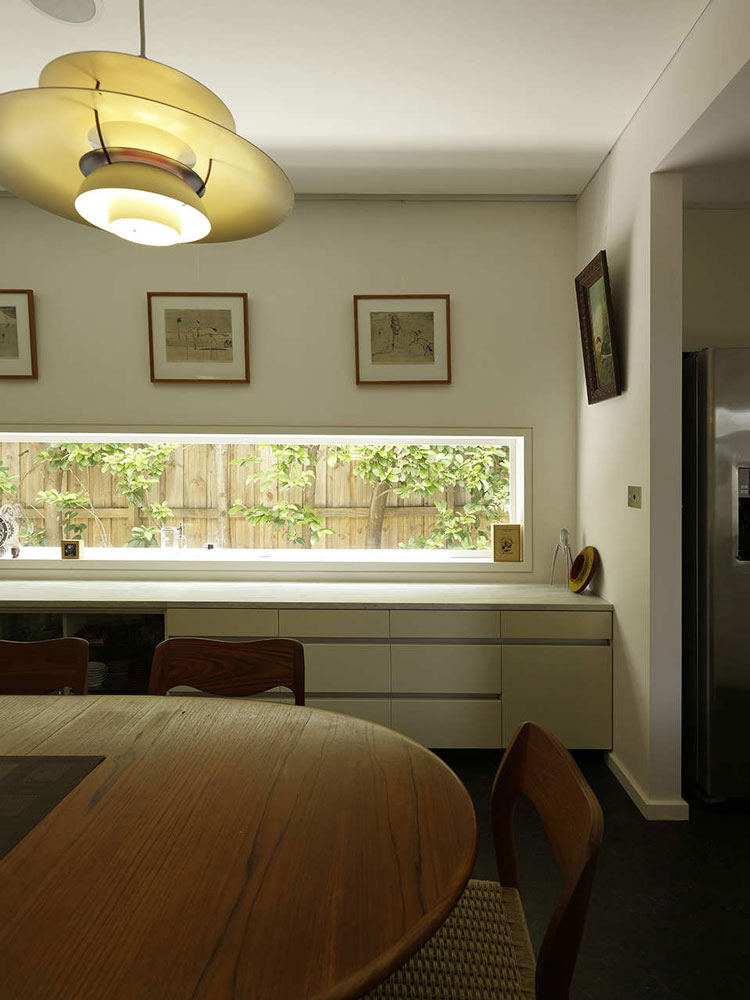 Haberfield House dining room has a narrow window and storage unit