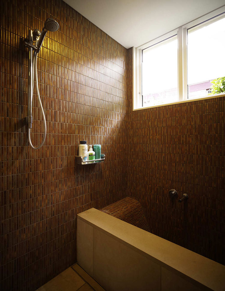 Haberfield House bathroom with mosaic tiles and sculpted build in bath