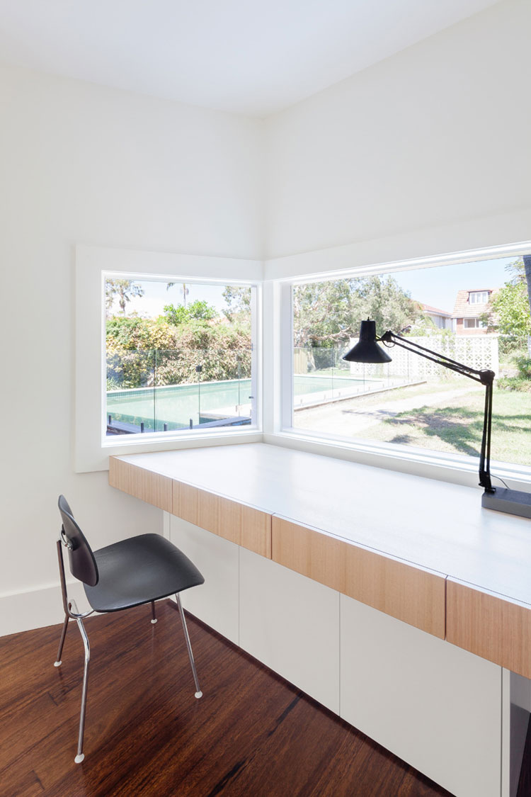 A built in desk in House Chapple's studio overlooks the garden and pool
