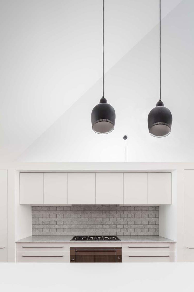 House Chapple's white kitchen has a textured dove gray tile splash back to inject texture and variety
