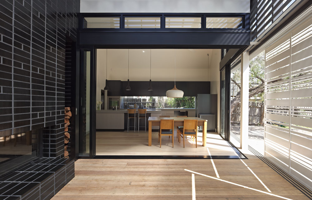 House Reduction's rear semi-enclosed deck acts as an outdoor room for the home