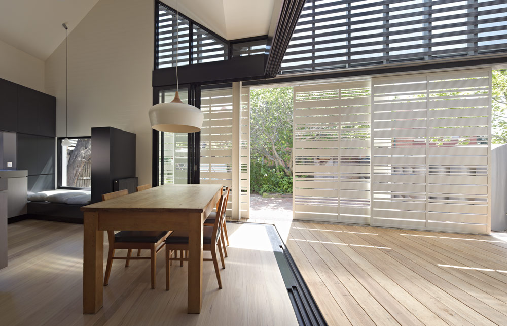 House Reduction has a sliding timber screen to moderate the amount of sunlight and privacy