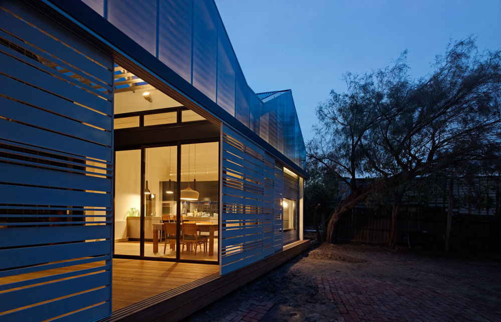 The new facade at the rear of the House Reduction glows at night