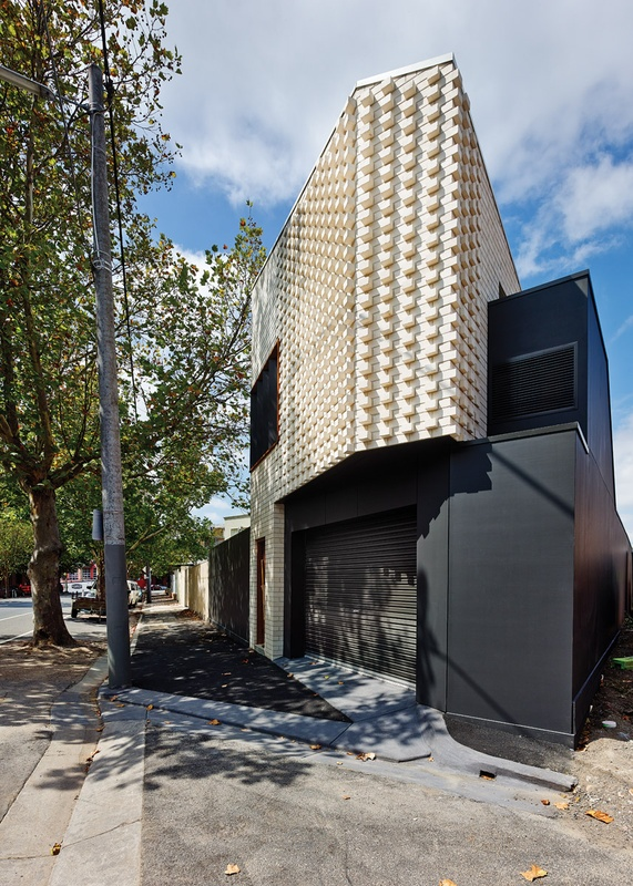 The rear garage and studio is built from brick and has a textural brick pattern in House Reduction