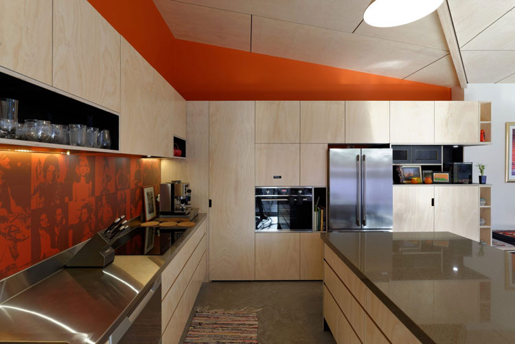 Splashes of orange enliven Islington House kitchen