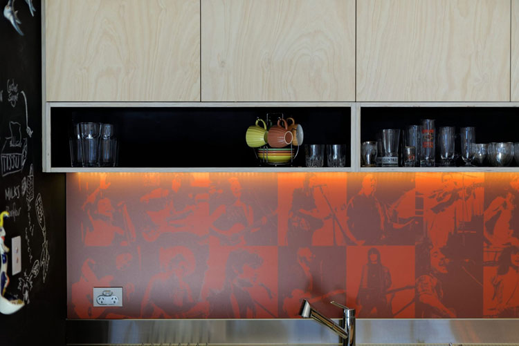 Islington House kitchen features a custom printed splash back to show off the owners' passion for music