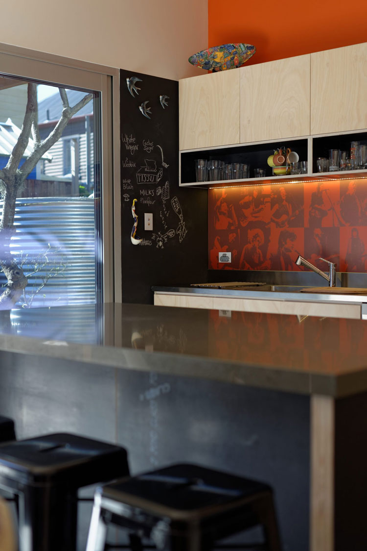 Islington House kitchen splash of orange, blackboard and benchtop
