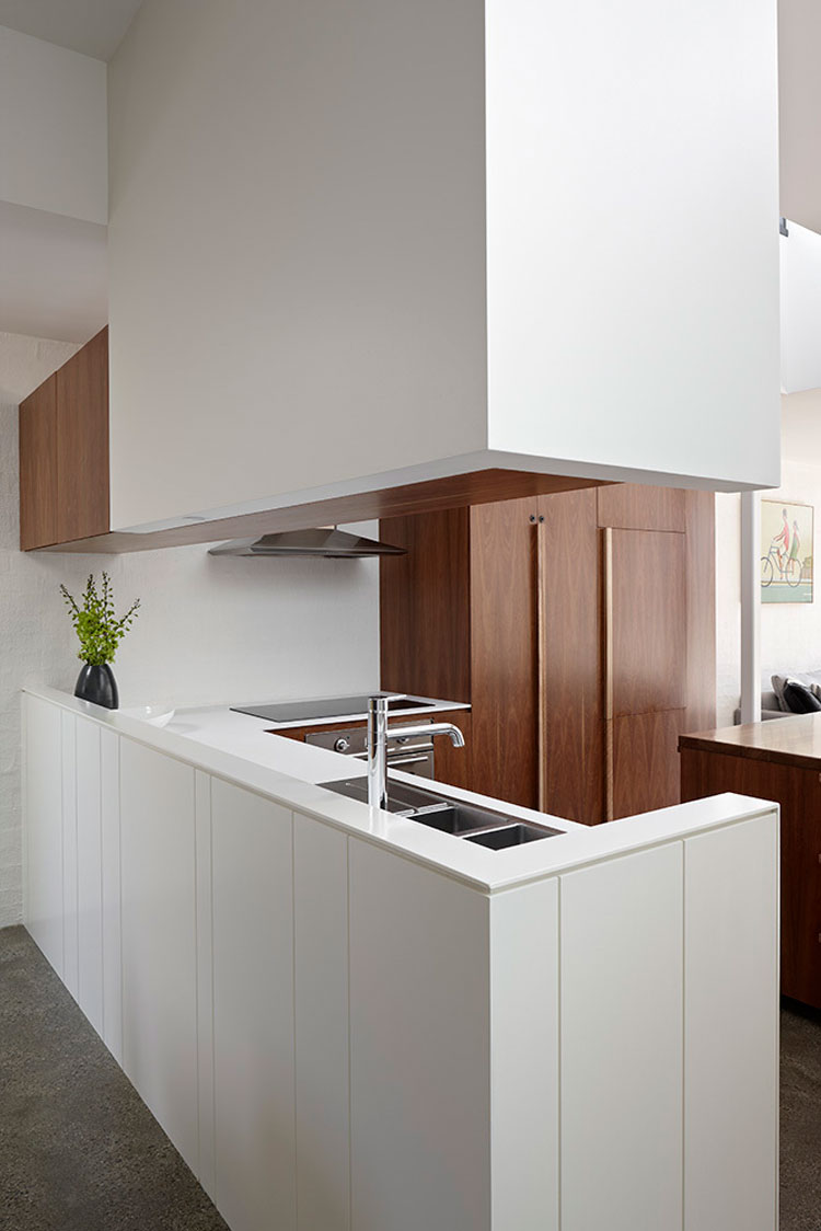 North Fitzroy House kitchen uses timber veneer and a textured white panel to look simple but not boring