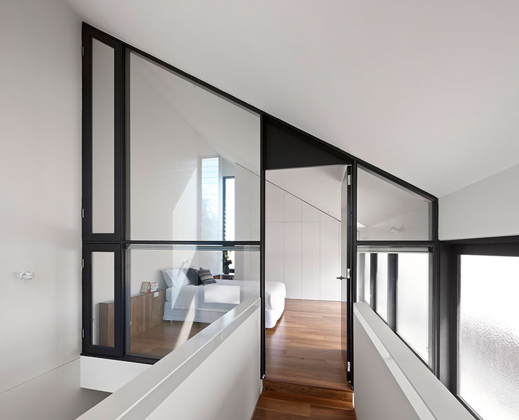 The bedroom is surrounded by glass, giving it acoustic privacy, but making it feel more like a mezzanine loft at North Fitzroy House