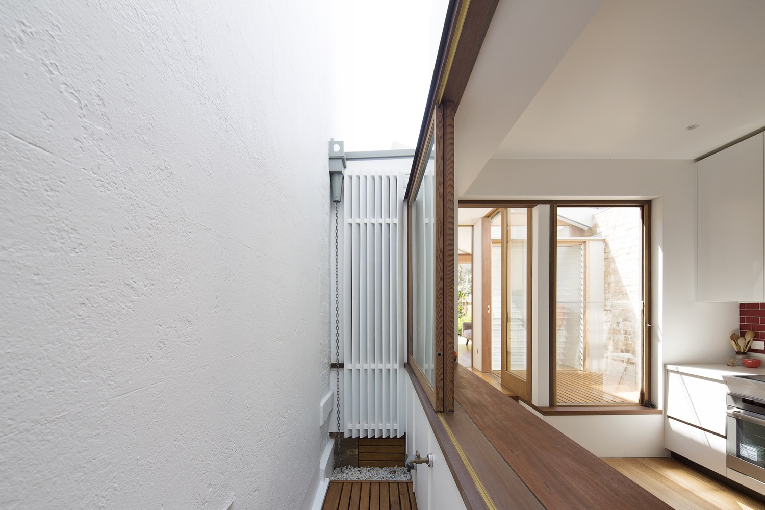 Back-of-House Renovation Makes This Courtyard House an All-Seasons Home