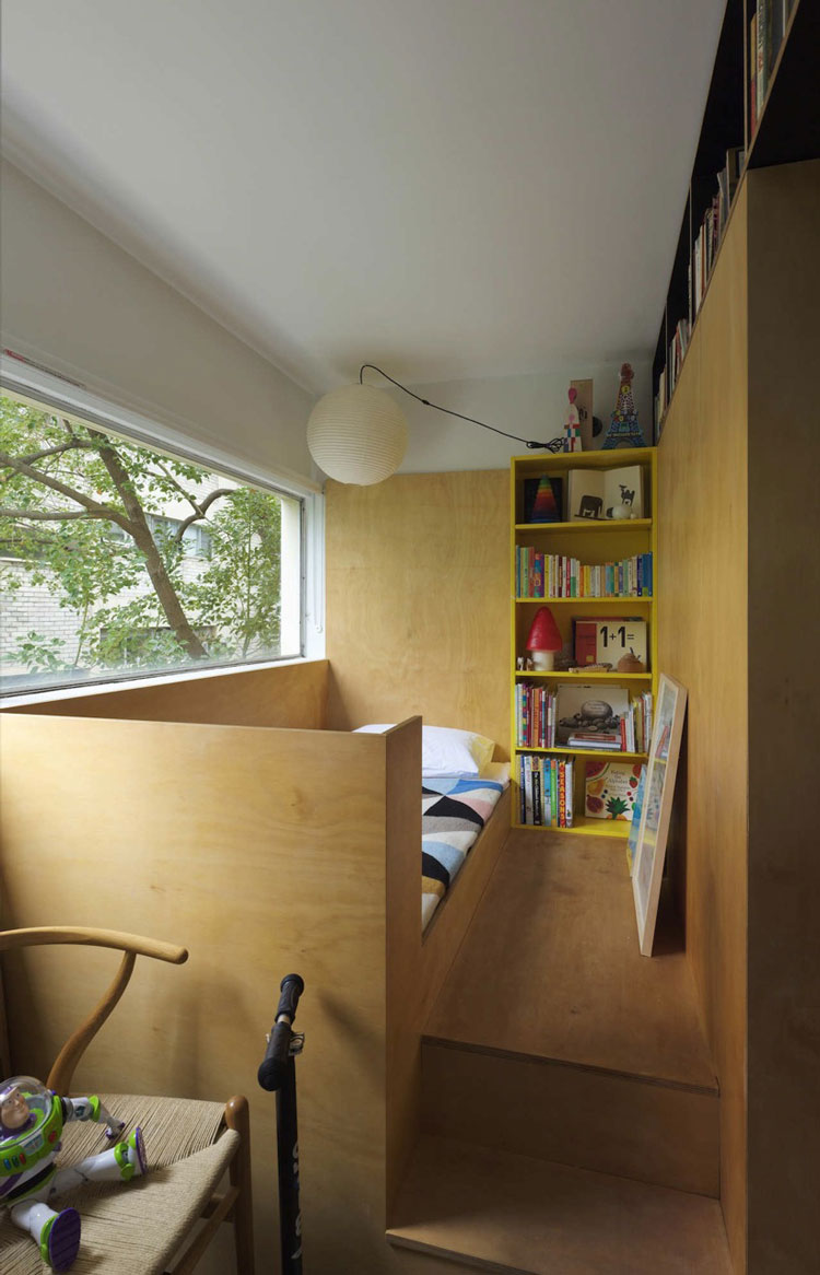 Potts Point Apartment child's bedroom is raised on a platform to make space for the adult's pull out bed