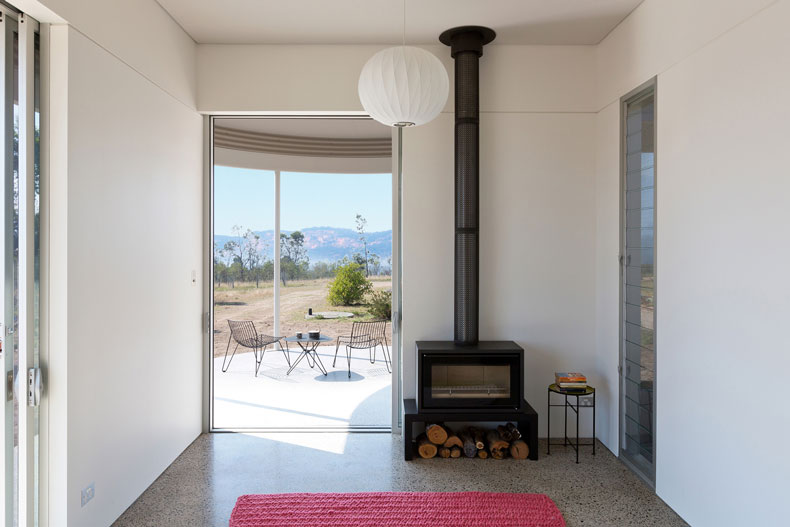 The Southern Highlands House has a small, efficient fireplace to keep the house warm in winter and louvre windows for ventilation and cooling in summer