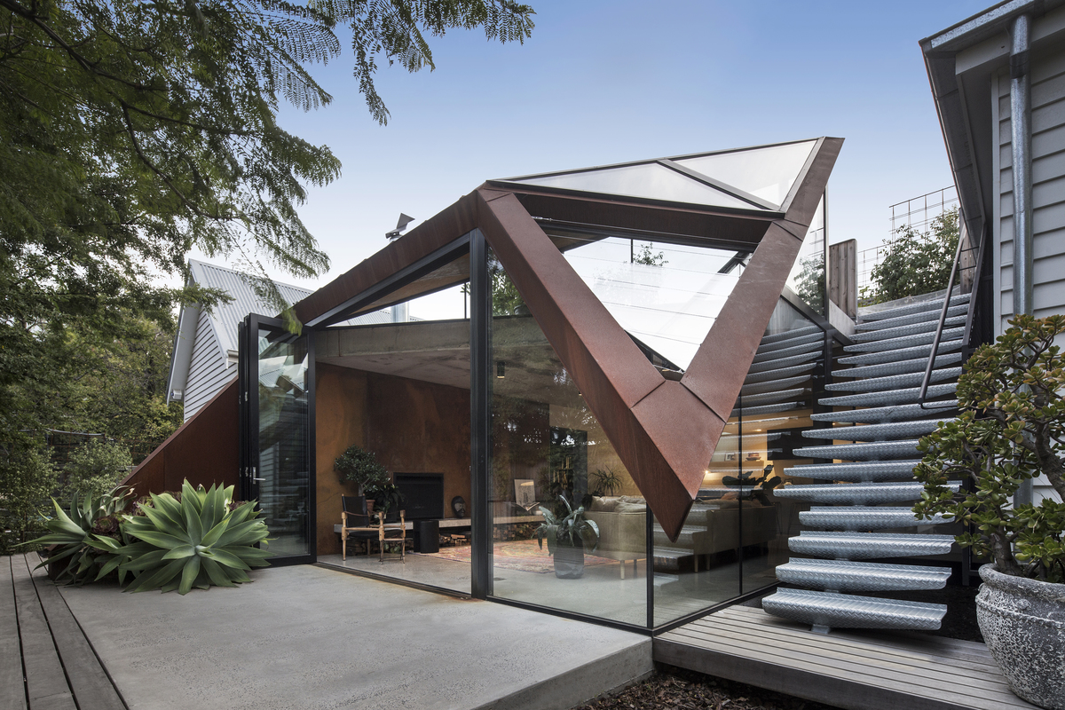 Glazed Roof Floats Like a Leaf Capturing Views of Trees and Sky