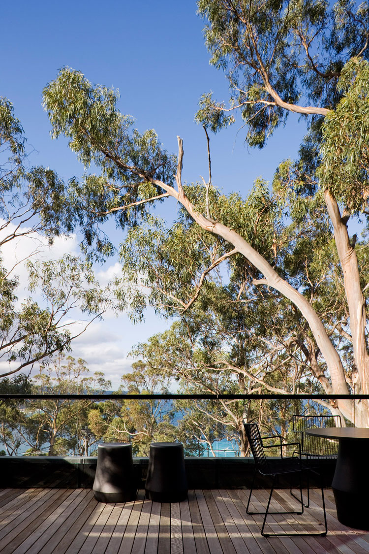 One of Treehouse's outdoor living areas overlooks the ocean and eucalyptus trees