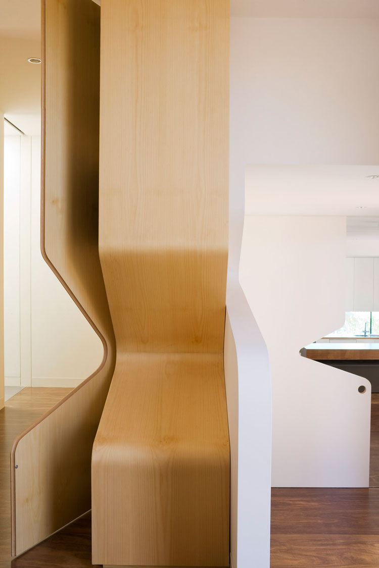 Treehouse cutout detail is even incorporated into a joinery unit which bends to follow the curving form