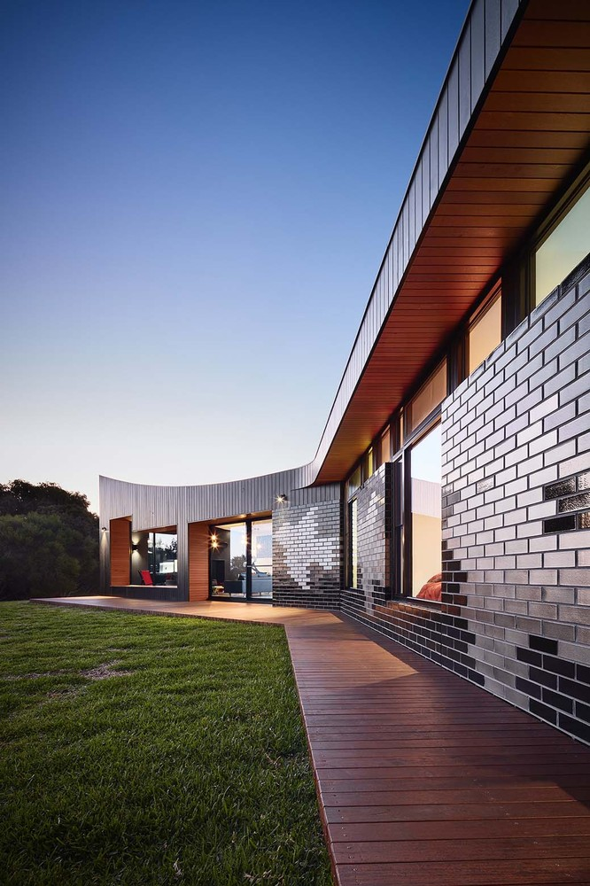 The Glazed Brick Facade at This Beach House is Inspired By Escher