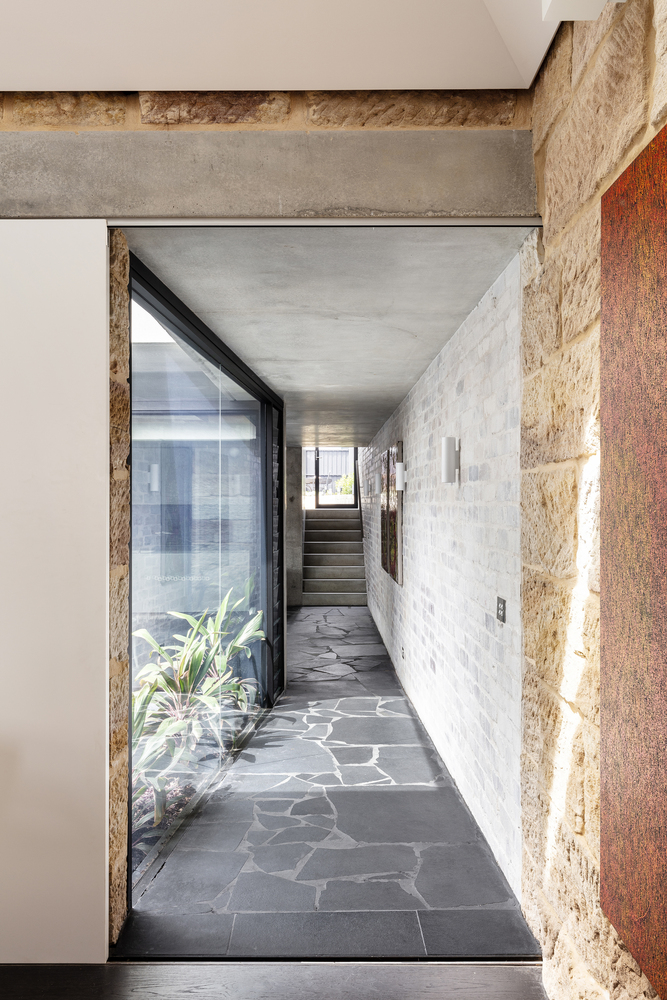 A Dramatic Concrete And Brick Addition To An Old Sandstone