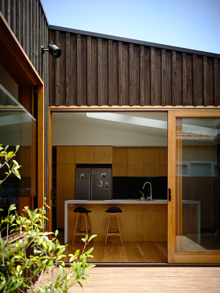 Batten and board house a simple 39 box 39 transforms a for Board and batten homes