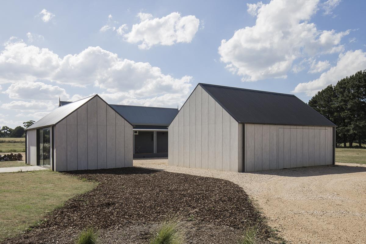 Modern barn outside minimal studio and gallery space inside for Barn homes australia