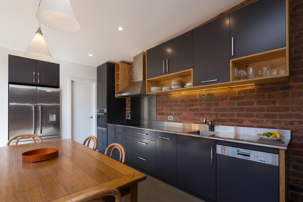 Renovation achieves an energy positive and income for A z kitchen cabinets ltd calgary