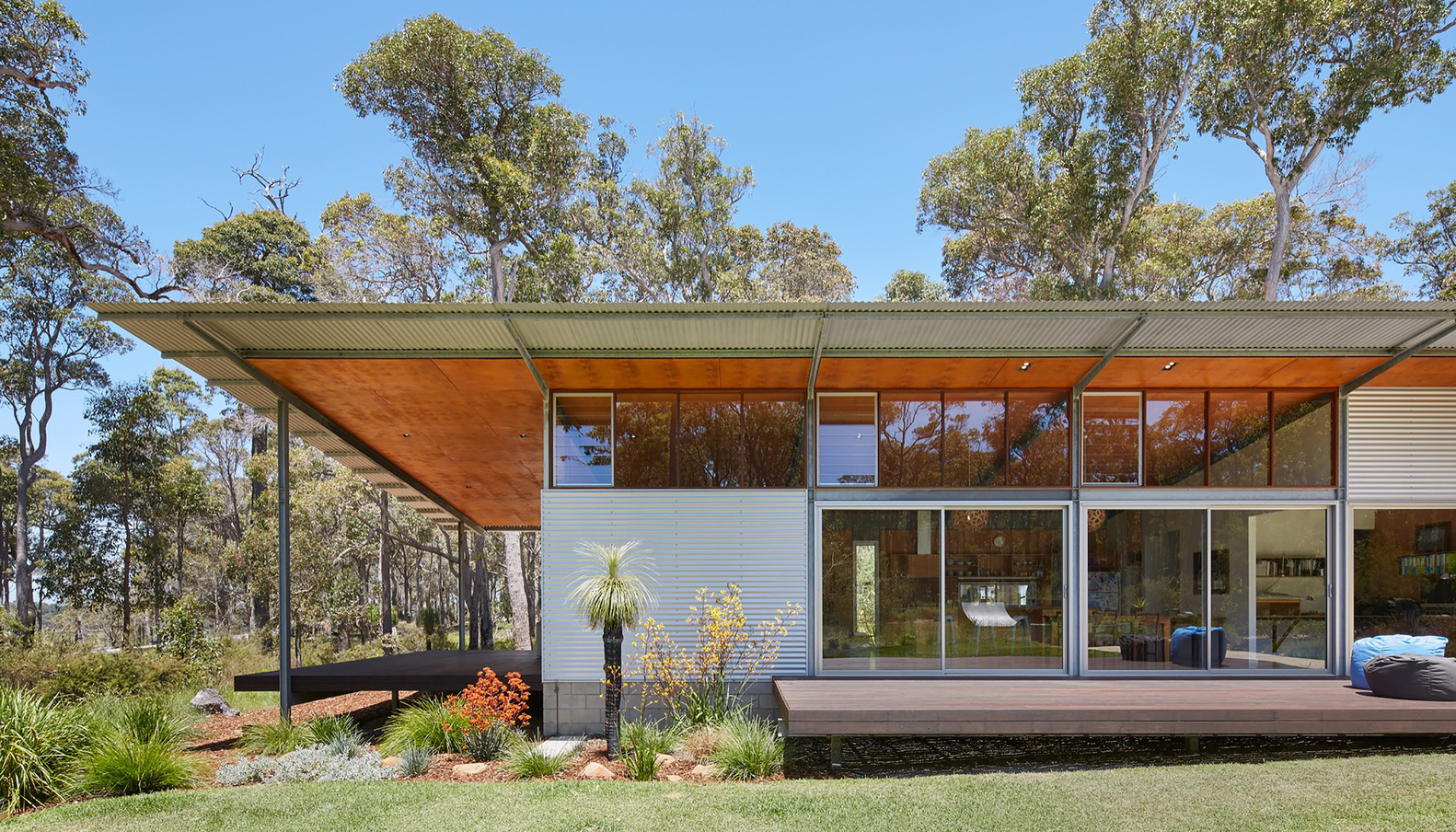 A home inspired by the feelings of camping under a simple for Bush house designs