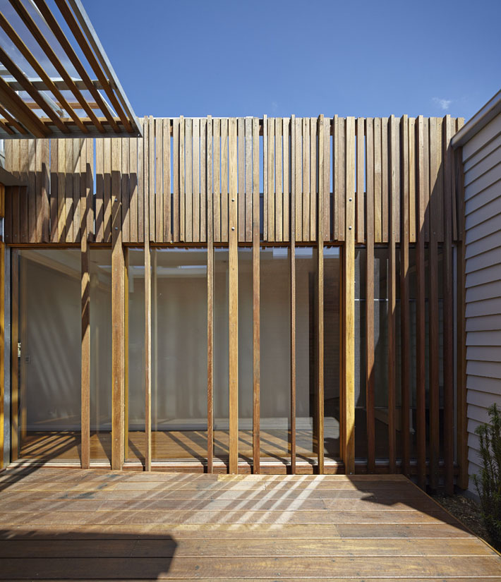 Modern Wood Screen Wall ~ Convertible courtyard house when the clouds roll in so