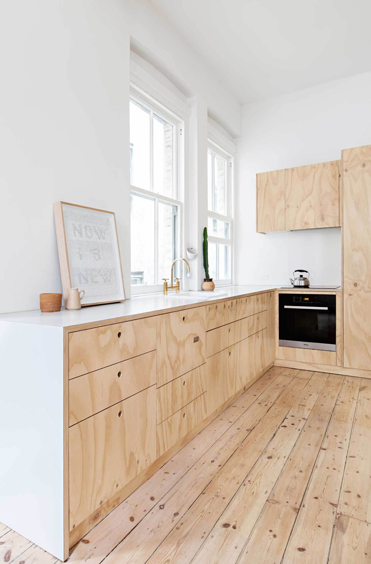 Flinders Lane Space Efficient Apartment plywood kitchen