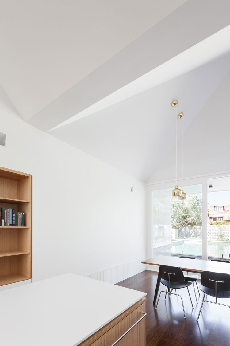 The ceiling folds and bends overhead to define the various spaces in the open plan living area
