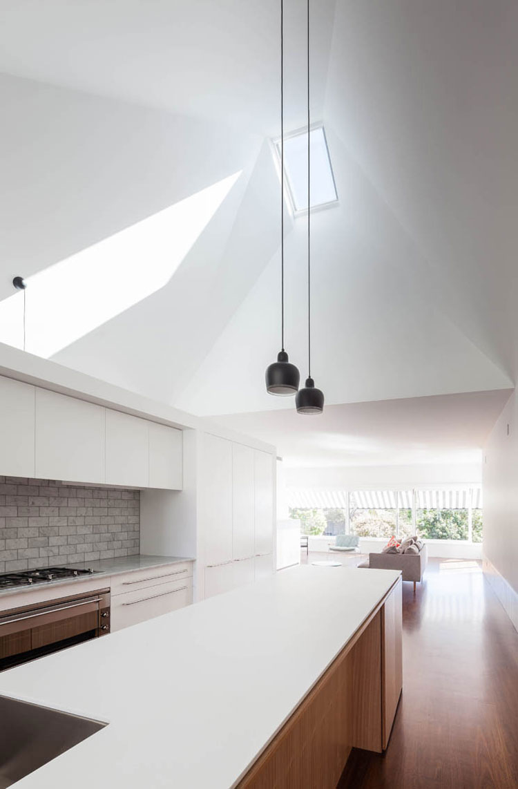 House Chapple's north facing skylight over the kitchen lets the sun in, which is then bounced around the pyramid-shaped ceiling