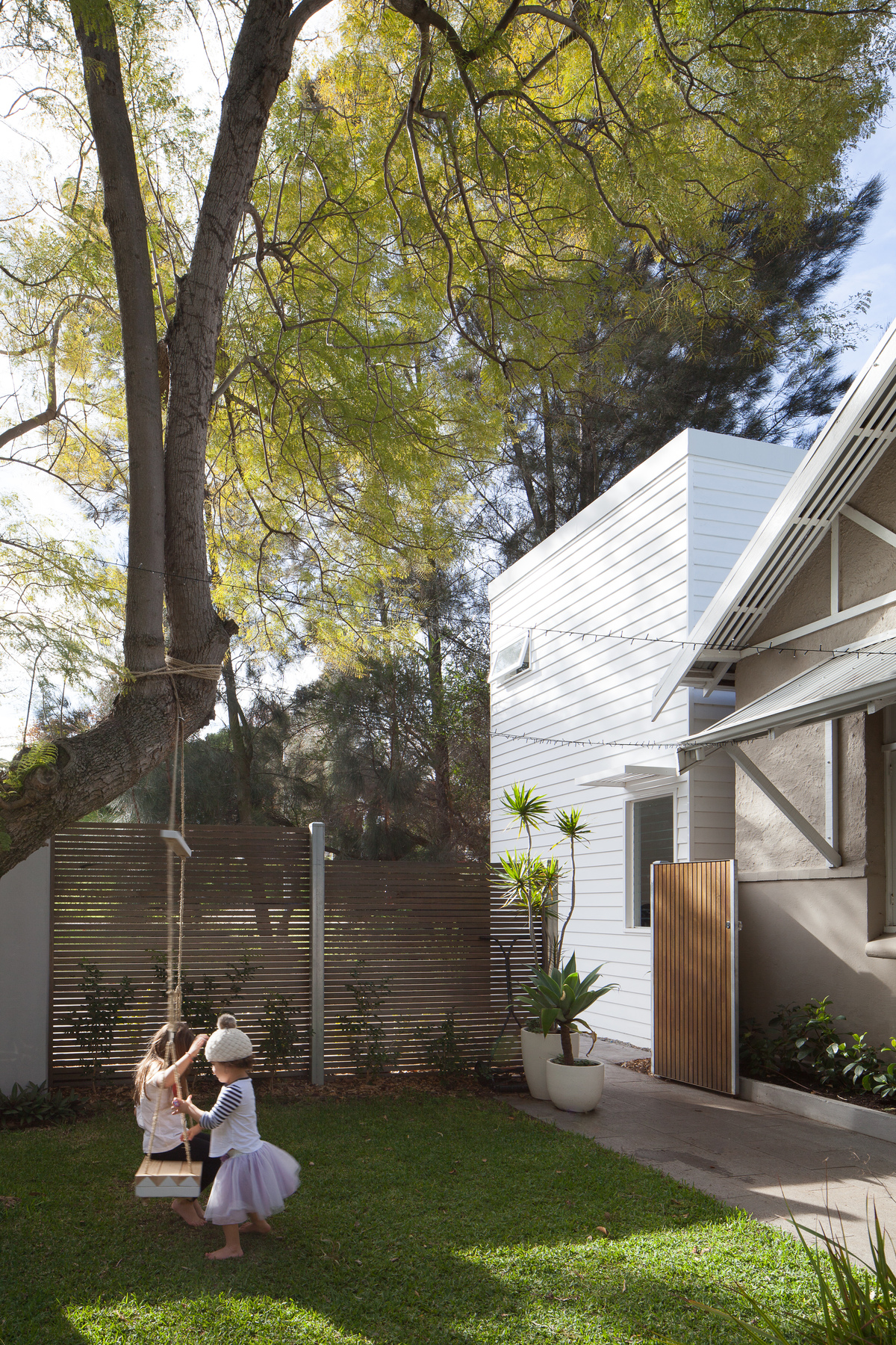 A White Box is 'Plugged' Into the Side of This Existing Home