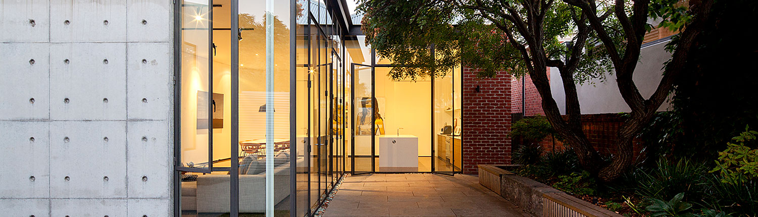 A Modern Extension of Thin Steel, Glass, and Concrete Adorns ...