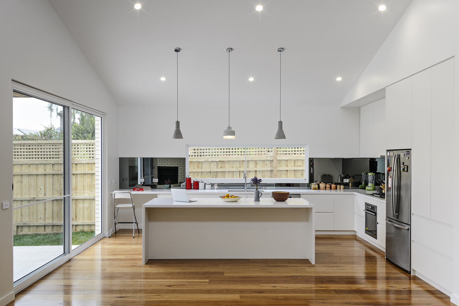 Backyard Extension Takes its Cues from Nearby Buildings and Garages