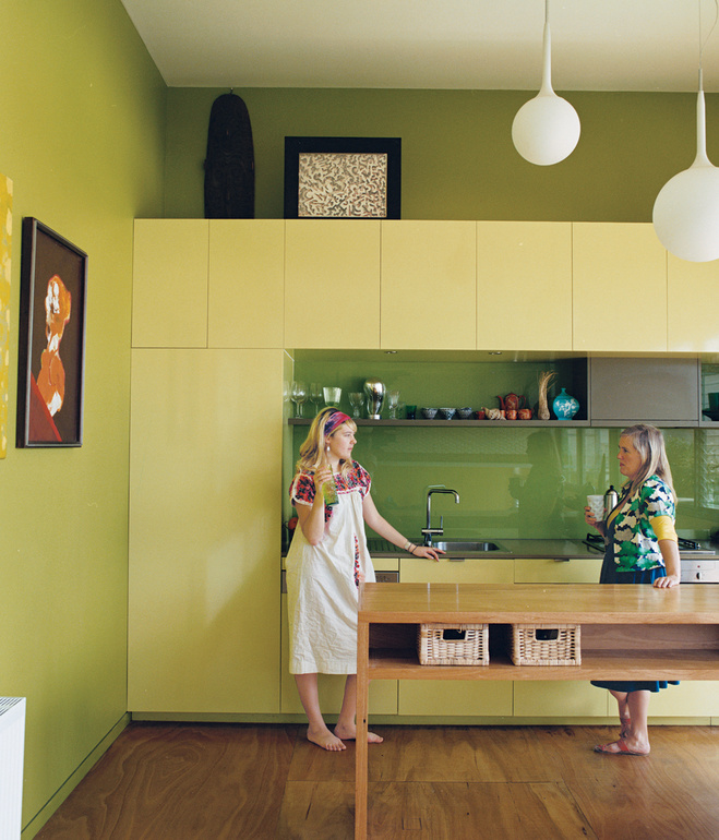 Cat Macleod and daughter Celeste enjoy drink and a chat in their modern kitchen in their home Polygreen