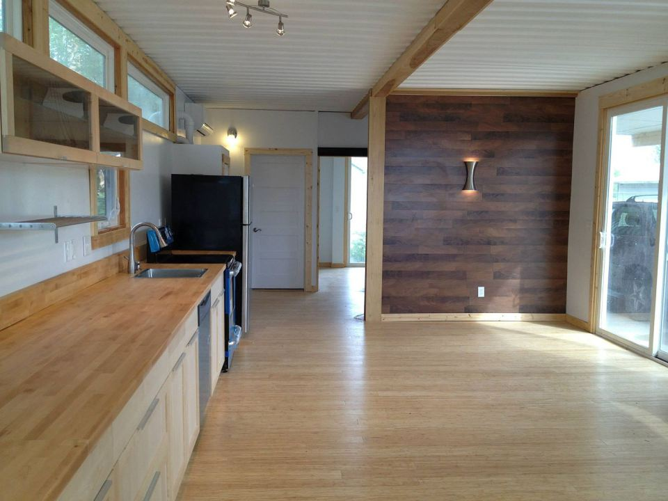 Looks are deceiving at this eco friendly shipping - Shipping container homes interior ...
